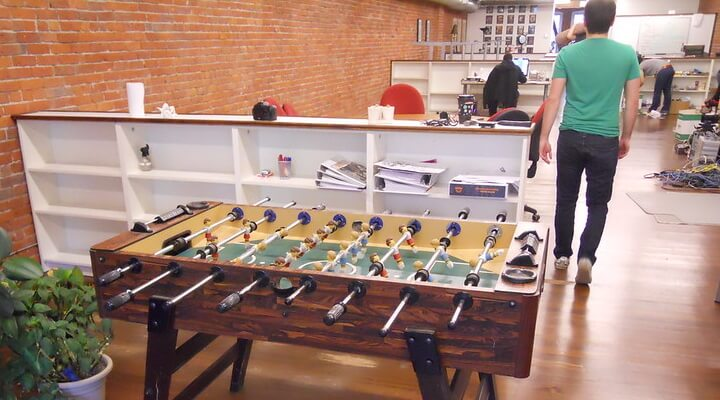 Playing foosball in the office